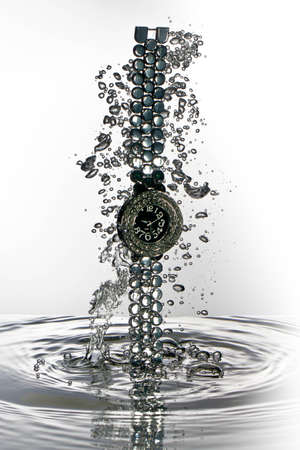 Watch water splash, wristwatch  photo