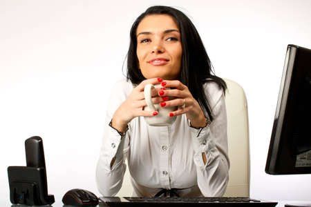 Business woman at her office desk Stock Photo - 12301037