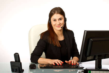 Business woman with headset at her office desk photo