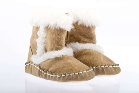 sheepskin: Kids boots made of fur and leather