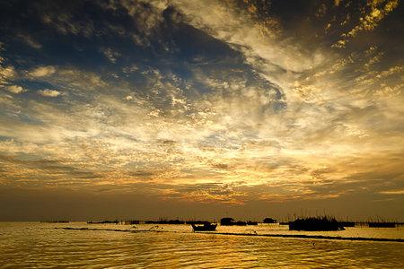 Dramatic sky over a lake photo