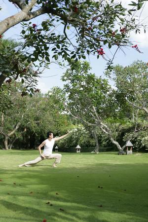 qigong: Young man practising Qigong