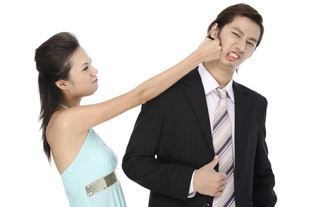 Young woman knocking young man at face Stock Photo