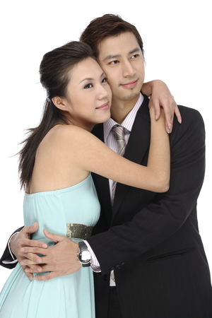 fondling: Portrait of young couple holding each other