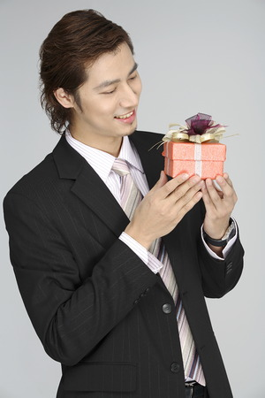 Young man holding a gift box