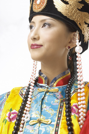 Close-up of young woman wearing ancient costume