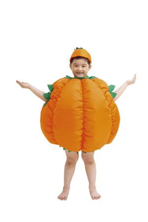 Little boy wearing pumpkin clothing