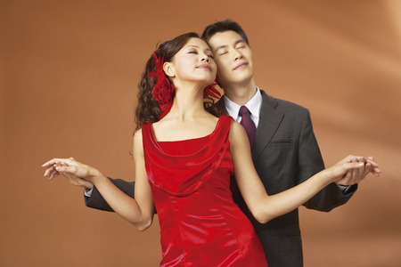 Portrait of young couple wearing wedding dress