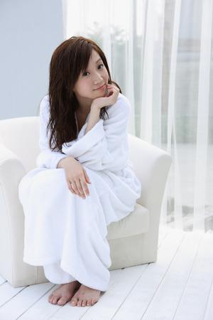 oriental bathrobe: Girl in bathrobe sitting in sofa