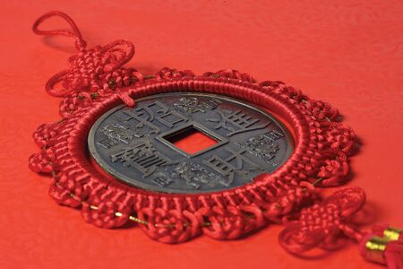 Chinese knot with Chinese coin in it  Stock Photo