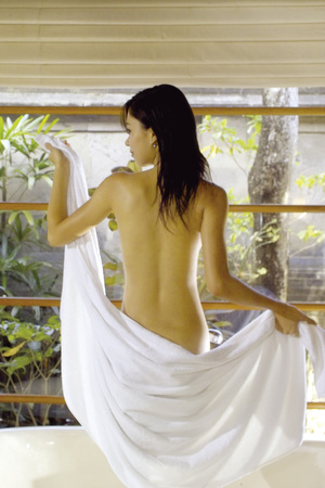 Back view of woman wearing bathrobe