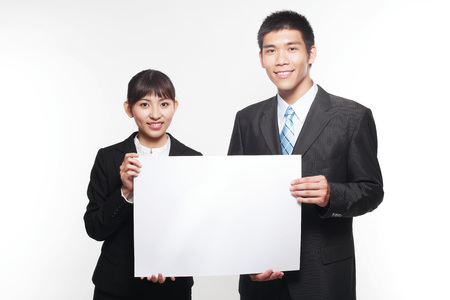 argumentation: Portrait of two young people in business suit with a cardboard in hands