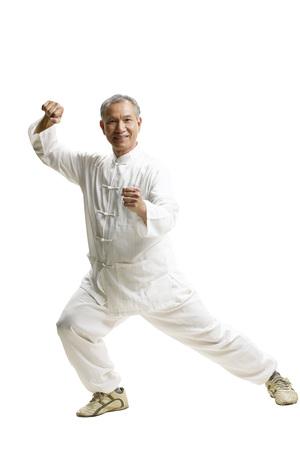 Portrait of senior man wearing Tai Chi clothes Banco de Imagens