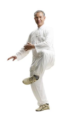 Portrait of senior man wearing Tai Chi clothes Standard-Bild