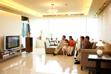 granddad: Three generation of a family spending time in the living hall