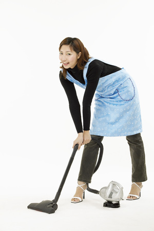 Portrait of young woman doing cleaning Banco de Imagens