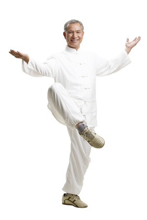 cheer full: Portrait of senior man wearing Tai Chi clothes Stock Photo