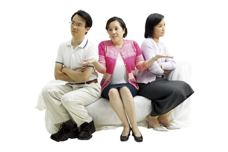 Three people sitting on sofa Stock Photo