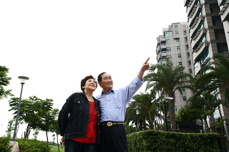 Portrait of senior couple at residential area