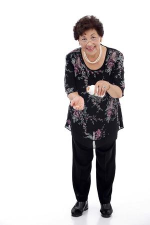Portrait of senior woman holding a bottle  of medicine