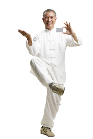 Portrait of senior man wearing Tai Chi clothes Stock Photo