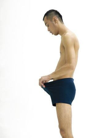 Side view of young man only wearing underwear Stock Photo