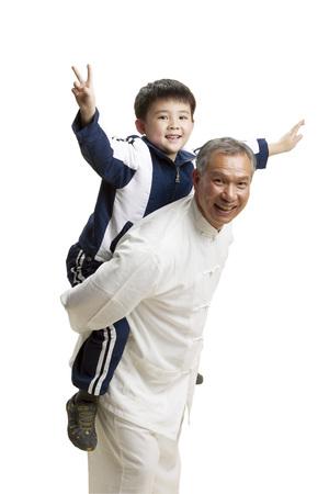 Senior man piggyback little boy Banco de Imagens