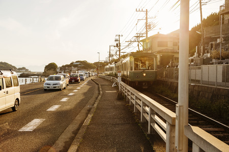 Japan railway with car road under sunset