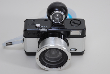 Close up view of a camera on white surface