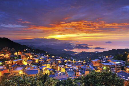 High angle shot of the sunset in the mountain village and the sea Jiufen Ruifang