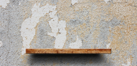 Wood shelf on brick wall. Polished cement floor. texture background. furniture.photo