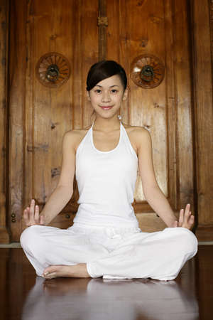 smiled: Young woman practising yoga LANG_EVOIMAGES