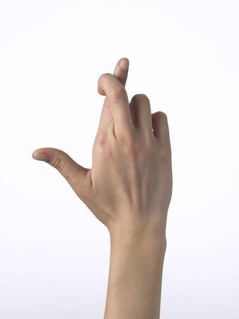 hope indoors luck: Human hand