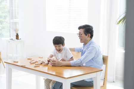 blind child: Grandfather accompany with grandson