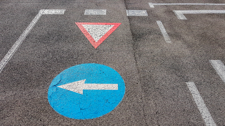 Turn left and wait for others traffic road sign symbol with white arrow pointing left inside a blue circle