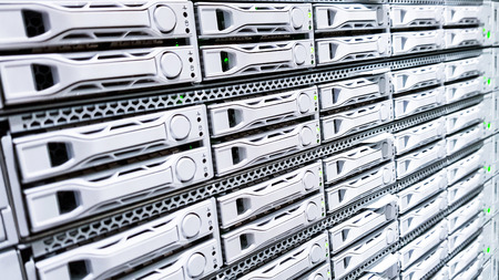 High capacity hard drive disk storage rack used for big data cloud services inside data server room close up 写真素材 - 120899344