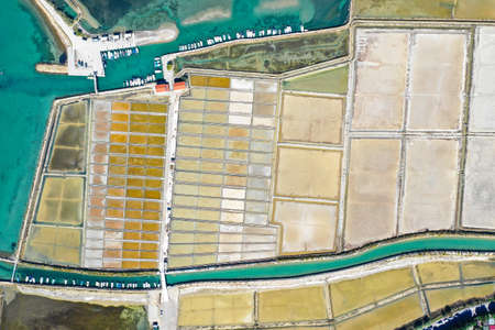 Aerial birds view from the sky of a salt pans fields structure and architecture pattern in Slovenia, Strunjan