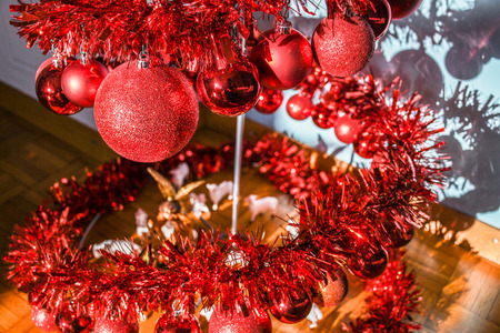 Modern metal spiral Christmas tree decorated with red shiny balls Imagens
