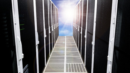 Modern big data server room corridor hallway with high racks full of network servers and storage blades and sun light at the end concept