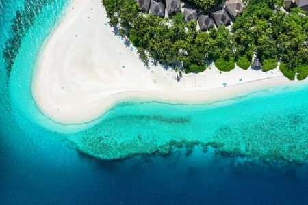 Aerial top down view with drone of an tropical exotic island paradise with turquoise crystal clear water and pure white sand beach
