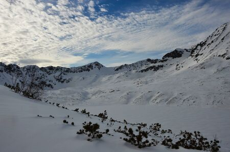 Mountain peaks against the blue sky.