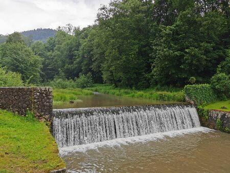 Poland Pieniny Mountains. Waterfall on a small river. Archivio Fotografico