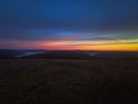 Red sunrise at the top of the mountain. Sunrise in the Bieszczady mountains Carpathians. Outline of the mountains.