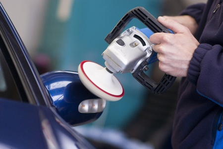 valeting: Car wax on wing mirror using rotary buffer Stock Photo