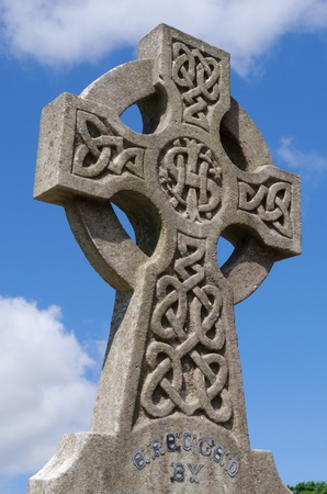 gravestones: Example of pre 1900 irish celtic cross with traditional celtic carving detail from a grave in the famous landmark Milltown Cemetery Belfast, which is the largest Catholic burial ground in Belfast and synonymous with Irish Republicanism.