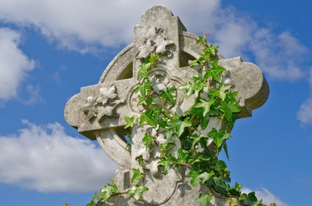 Example of pre 1900 irish celtic cross with traditional celtic carving detail from a grave in the famous landmark Milltown Cemetery Belfast, which is the largest Catholic burial ground in Belfast and synonymous with Irish Republicanism. photo