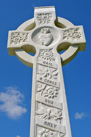synonymous: Example of pre 1900 irish celtic cross with traditional celtic carving detail from a grave in the famous landmark Milltown Cemetery Belfast, which is the largest Catholic burial ground in Belfast and synonymous with Irish Republicanism.