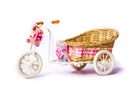 Wooden toy tricycle.