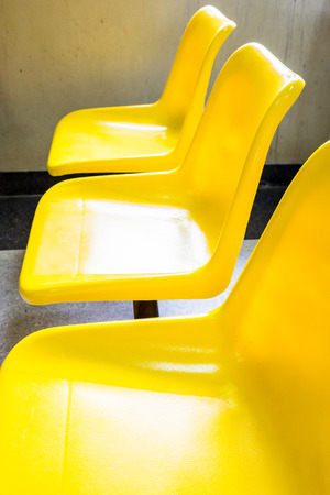 awaiting: Yellow chairs for patients awaiting examination.