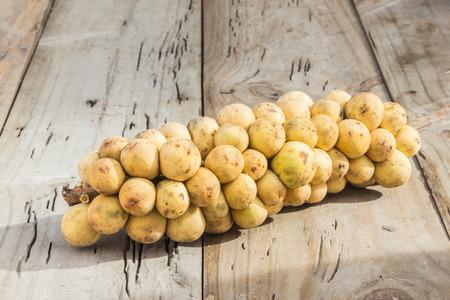 lanzones: Longkong fruits on wooden floor